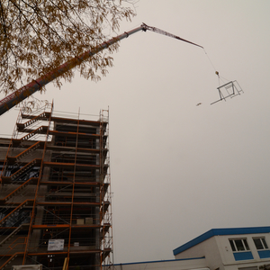 "… then it was lifted by a crane to its future location. The little dab next to the ""flying frame"" could have been a plane – but there is no plane seen on the other photos. The photographer swears that there was absolutely no plane around at this time! The Truth is out there, somewhere"